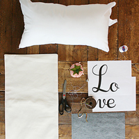 Darleen gold sequin word script pillow featured image